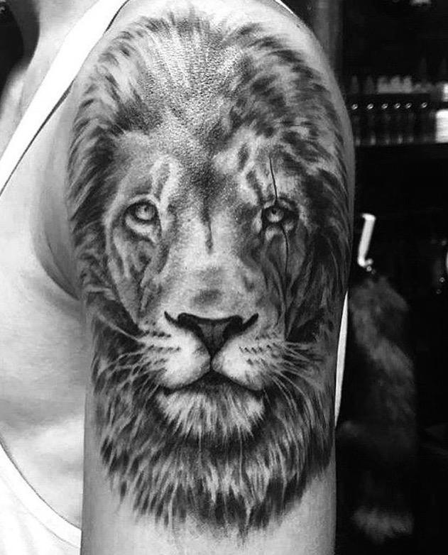 Black and grey realistic lion tattoo Bali