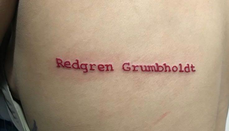 red ink typewriter tattoo