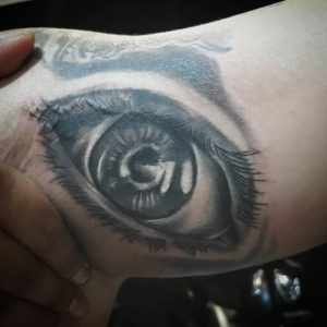 Black and grey eye tattoo by Gendunk13 Bali tattoo artist