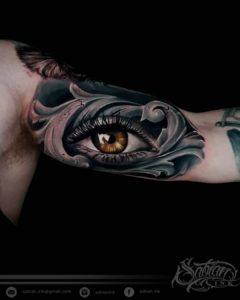 Brown eye tattoo by Sabian Ink artist Dena Rio