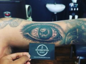 Eyeball with clock Roman numerals by Kuta Inked Tattoo