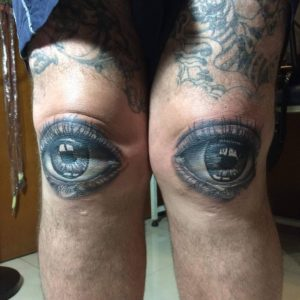 Kneecap tattoos of eyes by Manik Sumbang komingchaobigbrothers
