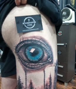 Kuta Inked Tattoo blue eye on thigh